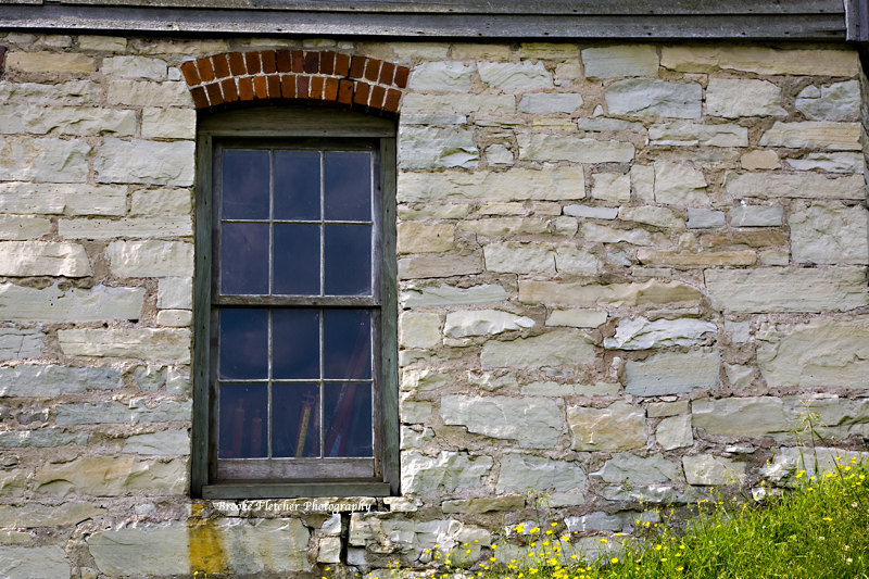 Window in buliding in Fayette Historic Townsite in Michigan